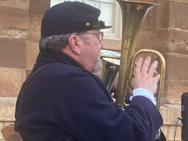 """Bob Jackson of Bloomington plays the alto horn as part of the 33rd Illinois Volunteer Regiment Band's concert at the Old State Capitol in downtown Springfield Saturday evening. The band played as part of the History Comes Alive program. The volunteer regiment was known as the """"Teacher's Regiment"""" because it was formed from many college students on the campus of the Illinois State Normal School, now Illinois State University. The band was organized in 1996 and members play Civil War era musical instruments at re-enactments and other events."""