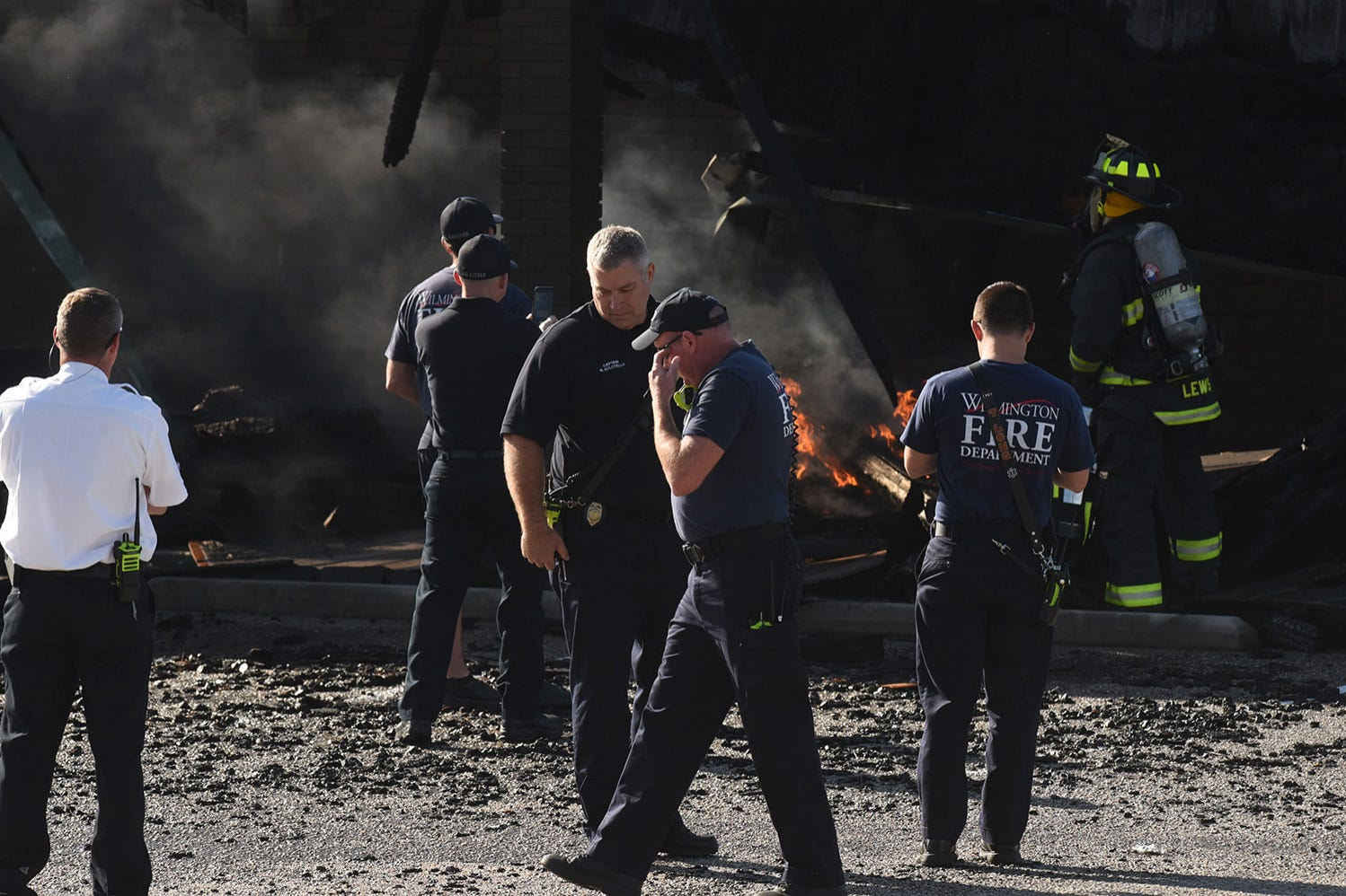 Wilmington Fire Department crews continue to look after the fire at Everybody's Supermarket, along Greenfield St. Thursday May 3, 2018 in Wilmington, N.C. The fire destroyed Village Plaza Shopping Center that included stores like Spiro's Breakfast and Lunch House and Quail's Quality Cuts. [KEN BLEVINS/STARNEWS]