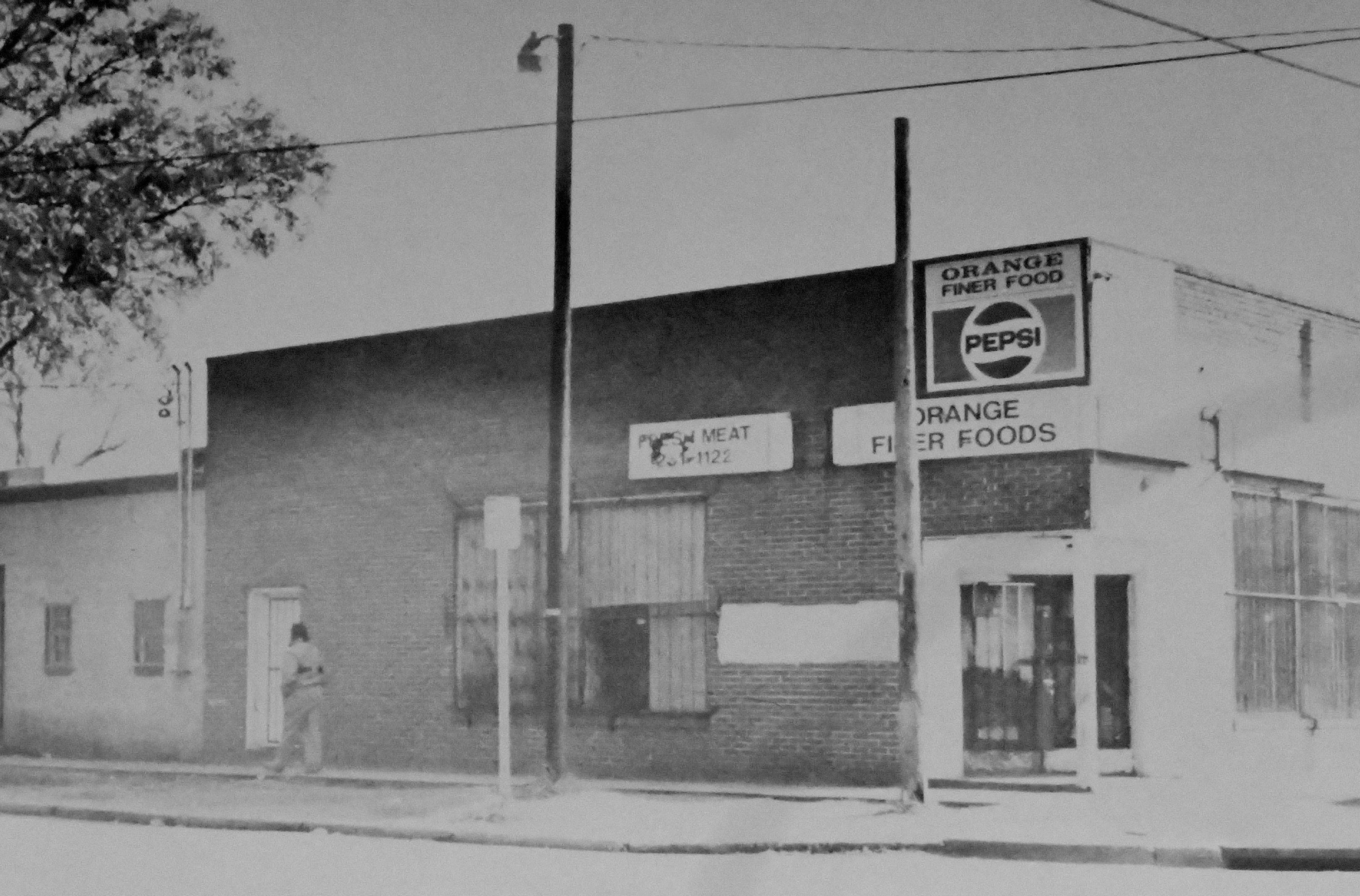 Orange Finer Foods on Orange Street in Wilmington, N.C., is shown on Jan. 21, 1992. Many small grocery stores like this one have closed over the years, leaving many residents without easy access to fresh food.