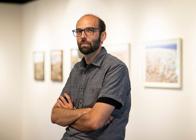 Worcester State University photography professor Eric Nichols inside the Exposure 2021 gallery show at the Ghosh Science And Technology Center.