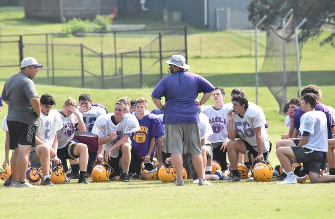 Paoli head coach Neil Dittmer speaks with his team following the second day of its team camp last week.
