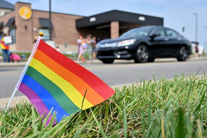 Pride flags lined the street at a pop-up pride event outside of Crossroads Church Oakley on Sunday, July 25, 2021. According to organizer Jack Crofts, the event is taking place in hopes that Crossroads will publicize their stance on LGBTQ members, after David Mahan, a guest speaker at the church on July 18, spoke about gender identity and transitioning in a way that offended many guests in attendance.