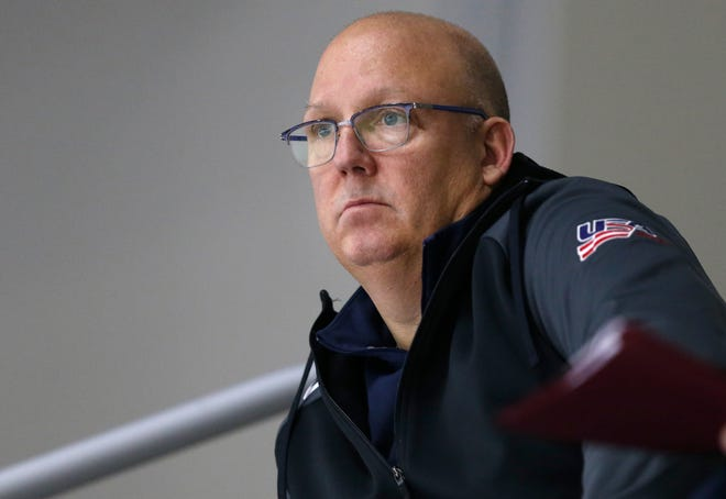 FILE - In this Dec. 17, 2017, file photo, United States' under-20 hockey coach Bob Motzko watches his team scrimmage during hockey practice in Columbus, Ohio.
