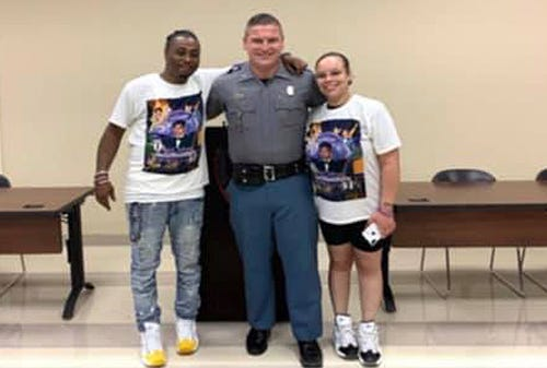 Louisiana resident Michael Williams (left) and Mississippi State Trooper Caleb McQueen (center). The woman (right) in the photo was not identified.