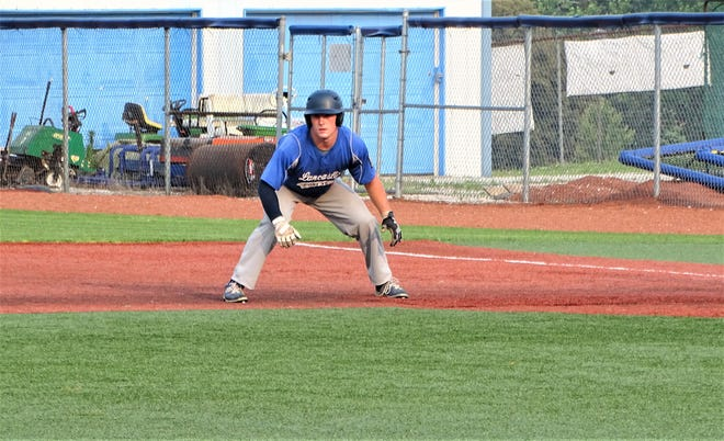 Lancaster's Ajay Locke, who plays for the Post 11 baseball team, leads off first base after collecting a hit during a recent game in the 8th District tournament. Locke, who is a middle linebacker for the golden Gales, is balancing baseball and football at the same time.