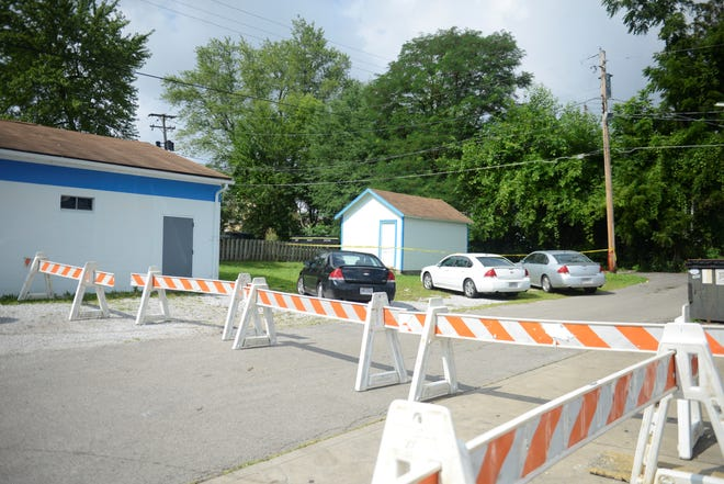 Mansfield police had barriers blocking the alley beside Joe and Mary's Market on Sunday morning.