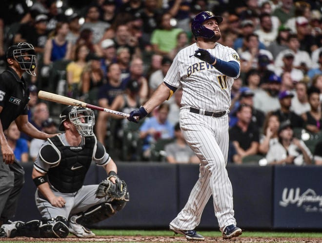 Brewers first baseman Rowdy Tellez and White Sox catcher Zack Collins watch Tellez's solo home run in the sixth inning Saturday night at American Family Field.