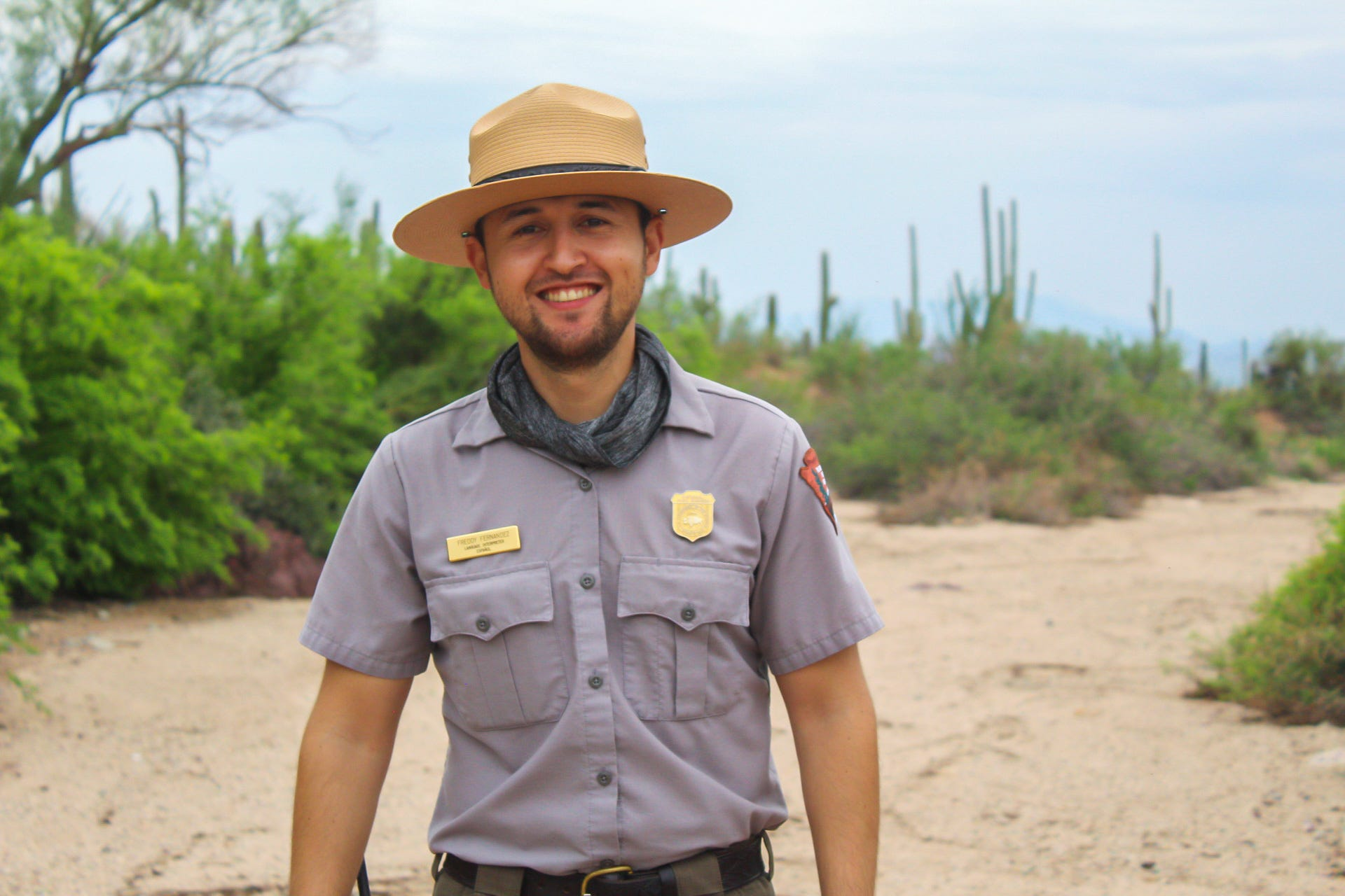 """As a Mexican-American, Freddy Fernández-Ramírez, a ranger in Saguaro National Park, uses his bilingualism to call more Latinos to use green spaces. Nature is a place that doesn't discriminate, he said, """"It's a place where everyone is welcome."""""""