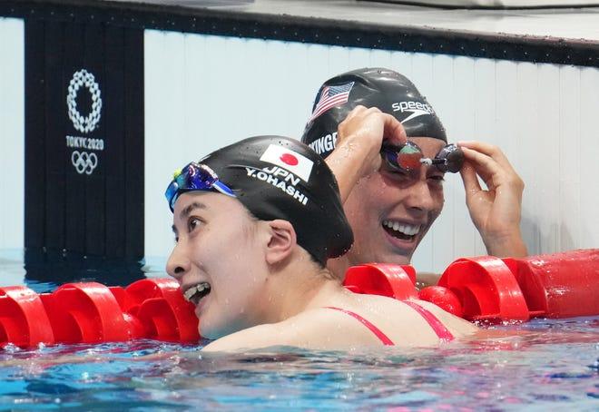 Jul 25, 2021; Tokyo, Japan; Yui Ohashi (JPN) and Hali Flickinger (USA) react after the women's 400m individual medley final during the Tokyo 2020 Olympic Summer Games at Tokyo Aquatics Centre. Mandatory Credit: Robert Hanashiro-USA TODAY Network