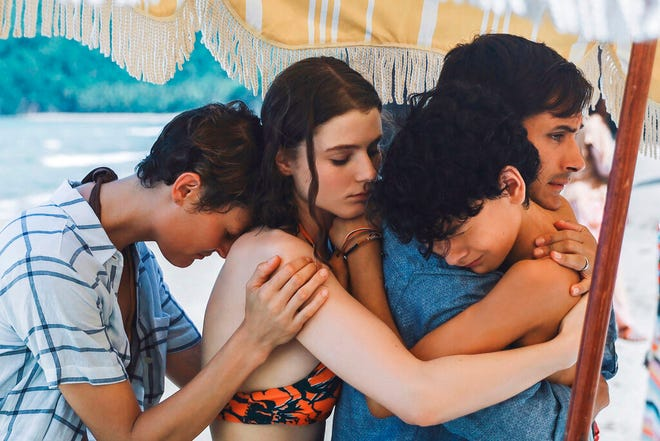 """From left, Vicky Krieps, Thomasin McKenzie, Gael Garcia Bernal and Luca Faustino Rodriguez star in """"Old."""" The movie is playing at Regal West Manchester, Queensgate Movies 13 and Hanover Movies16."""