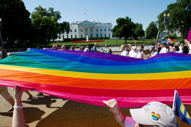 Demonstrators hold up a rainbow flag as they march outside of the White House during the  Equality March for Unity and Pride parade in Washington D.C., June 11, 2017. (Jose Luis Magana/AFP/Getty Images/TNS)