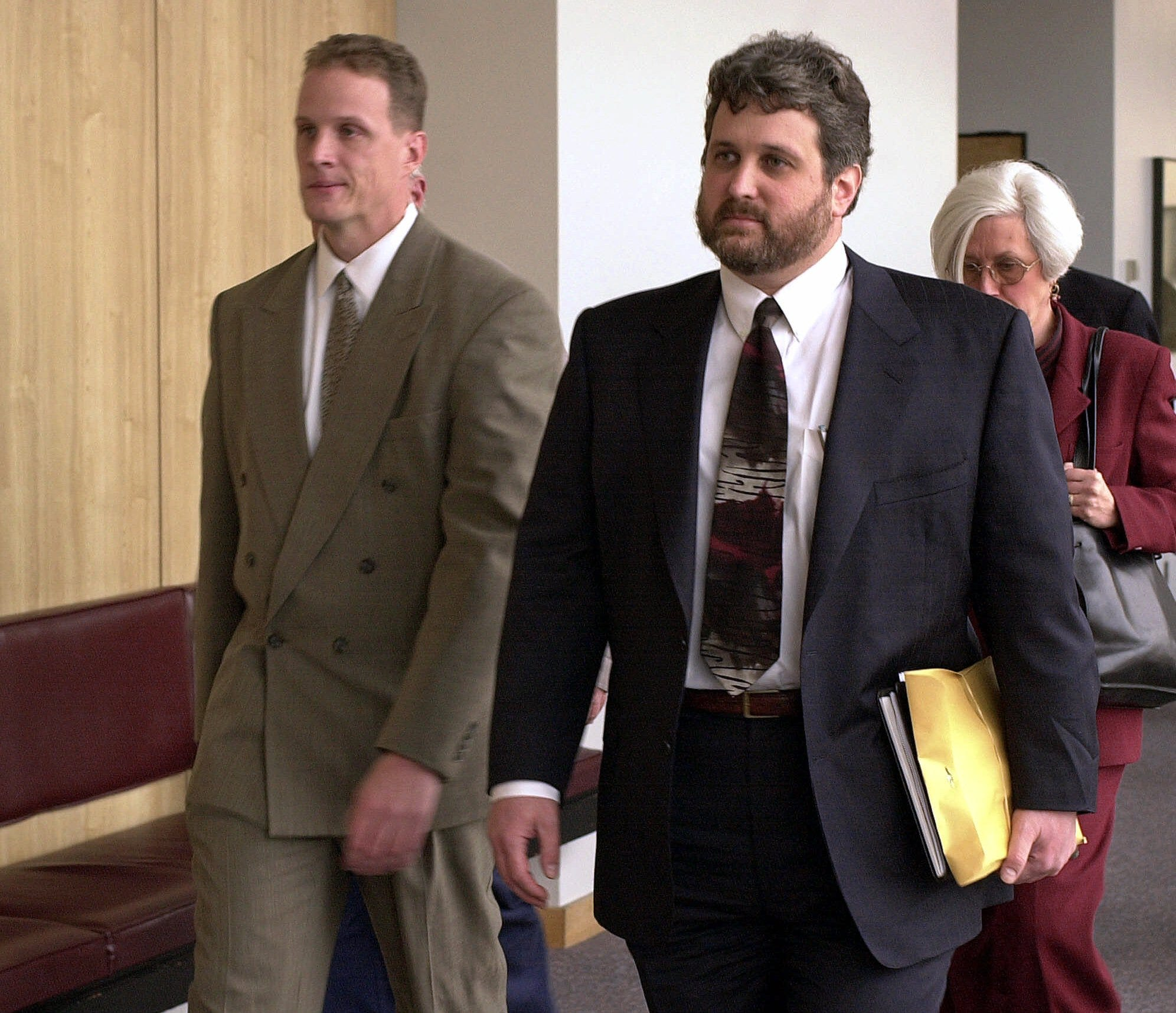 """Oakland police officer Matthew Hornung, left, and his attorney Ed Fishman exit a courtroom Dec. 6, 2000, at Alameda County Superior Court in Oakland, Calif. Hornung and other officers were charged in """"The Riders"""" scandal."""