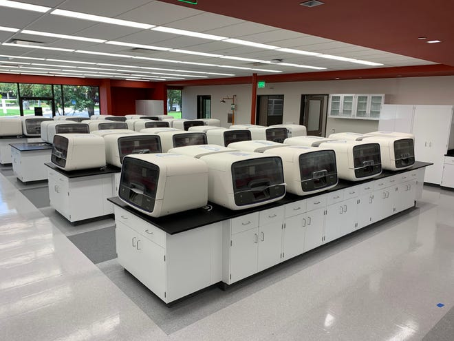 """Pictured at a Thermo Fisher Scientific facility in Austin is equipment the company says is """"used to support global response to the COVID-19 pandemic."""" Thermo Fisher is expanding its Austin operations, with the company sayint it plans to add several hundred jobs in Central Texas."""