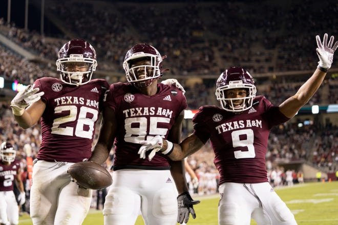 Texas A&M tight end Jalen Wydermyer, center, celebrates his touchdown catch against Arkansas with teammates Isaiah Spiller, left, and Hezekiah Jones. All three will play important roles this season for the Aggies.