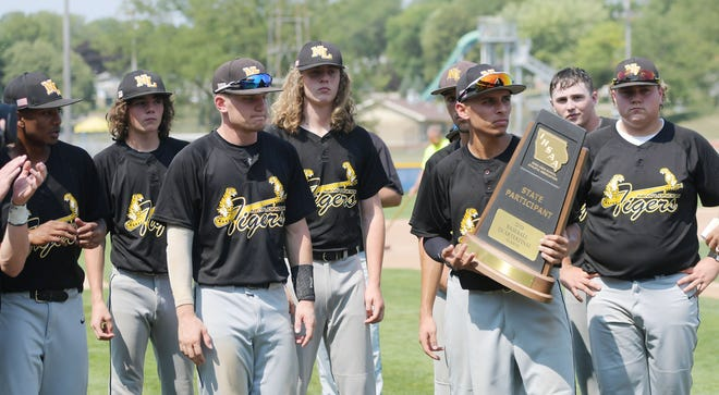 New London baseball team reacts after receiving the state participation trophy after losing 4-3 against Kee in the Class 1A baseball quarterfinal at Merchants Park Monday, July 2021, in Carroll, Iowa.