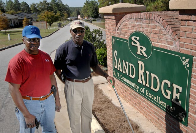 Augusta Commissioner Sammie Sias, left, and one-time friend Larry Hilton pose for a photo at the entrance of the Sandridge Community in 2007.