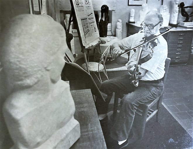 Musician, artist and college professor Nathan Bindler rehearses in 1983.