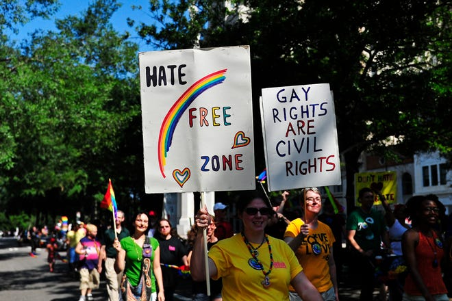An Augusta Commission committee takes up a nondiscrimination ordinance Tuesday. The ordinance bans discrimination based on sexual orientation and gender identity as well as race, religion, color, sex, disability, familial status, national origin, ancestry and military status. Here, participants carry signs in the 2013 Augusta Pride parade.
