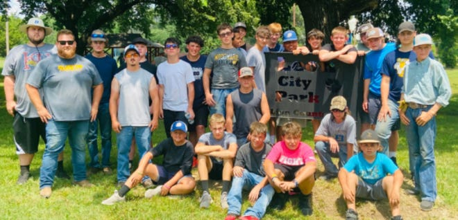Bluestem football players and coaches volunteering in Community Service Day in Leon