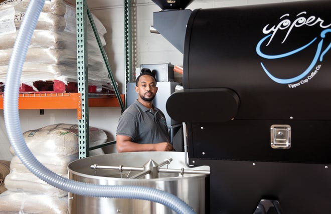 Mike Habte of Upper Cup Coffee photographed with his new coffee roaster in Columbus, OH on Friday, July 2, 2020.