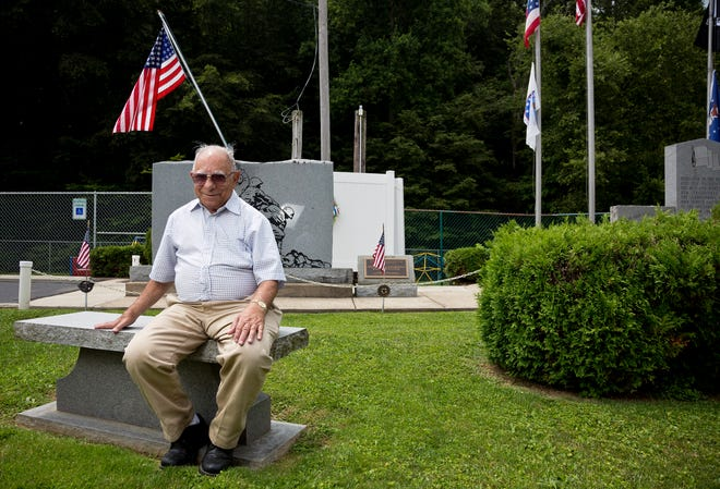 Joe Maroon with the New Straitsville veterans memorial he helped install photographed on Wednesday, July 21, 2021.