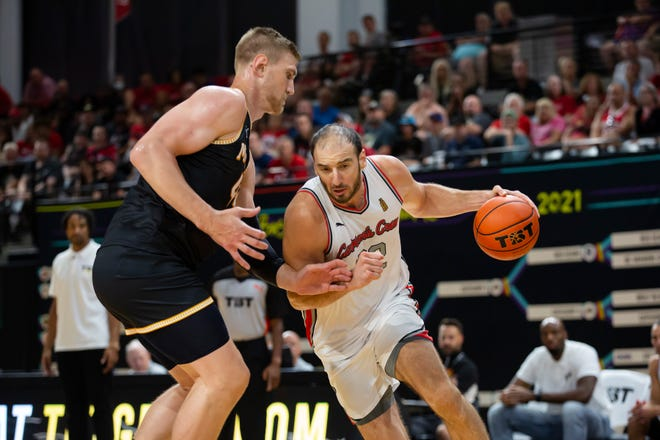 Carmen's Crew center Kosta Koufos drives a lane against Men of Mackey's center Isaac Haas at the Covelli Center. Carmen's Crew would go on to win the second-round TBT game 80-69.
