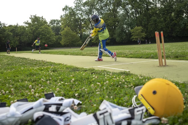 Raheed Zaman, 14, bats a ball during Delaware United Cricket Club's practice at Tuttle Park in Columbus.