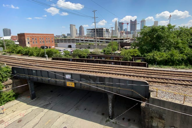 A view of the CSX railroad line as it passes over State Street in Franklinton with the Downtown skyline in the distance. The proposed Franklinton Loop Trail would include converting some of the railway into a multi-use walking and cycling path around the Franklinton neighborhood.
