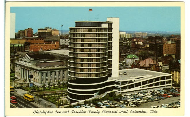 The Christopher Inn opened in July 1963 at 300 E. Broad St. at the site of the Alfred Kelley mansion. The circular building had 16 floors, 137 rooms and a heated pool. Designed by Karlsberger & Associates, including Leon Ransom, one of the first African American architects in Columbus, the Christopher Inn operated until 1988 and was demolished for a parking lot. To the left of the Christopher Inn is the Franklin County Memorial Hall, which was designed by Frank Packard and contains the offices of Franklin County Public Health.