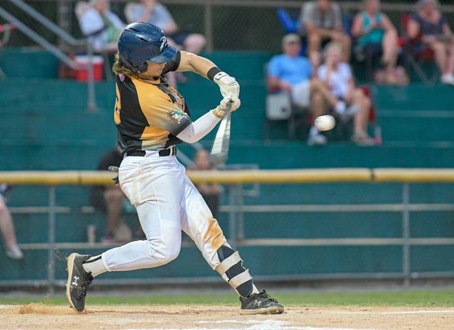 Leesburg's Travis Stapleton hits a solo home run against Seminole County on July 20 at Pat Thomas Stadium-Buddy Lowe Field in Leesburg. [PAUL RYAN / CORRESPONDENT]