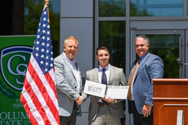 Nicolas Matzirakis, center, is presented with an appointment to the U.S. Military Academy at West Point by Martin Plumlee, West Point alumnus, left, and Reuben Dickenson right,, congressional district coordinator for West Point admissions.