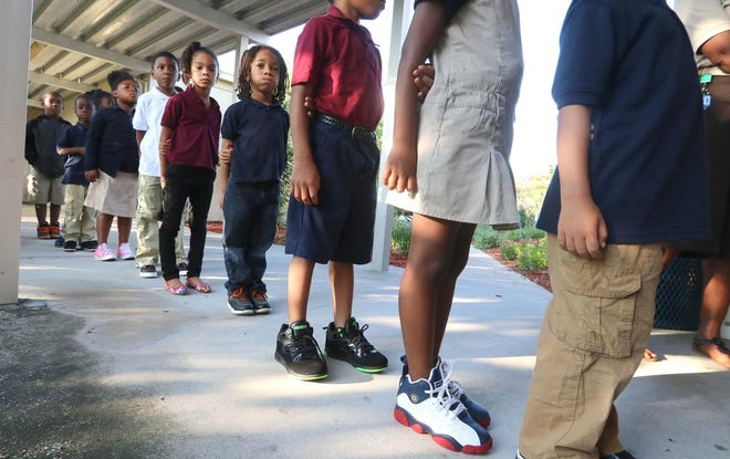 The uniform policy was criticized as being hard to enforce at the high school level.