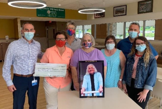 A check totaling $13,300 was presented by the Shick family to St. James Hospital CEO Bryan O'Donovan on July 22. Left to right: Bryan O'Donovan, Becky Shick, Marge Gursey, Judy Harris, Martha Wraight, Matt Shick and Abbie Shick. Family matriarch, Anita Shick, is featured in front. Not pictured: Dave and Pat Shick of New Jersey, who played in the tournament.