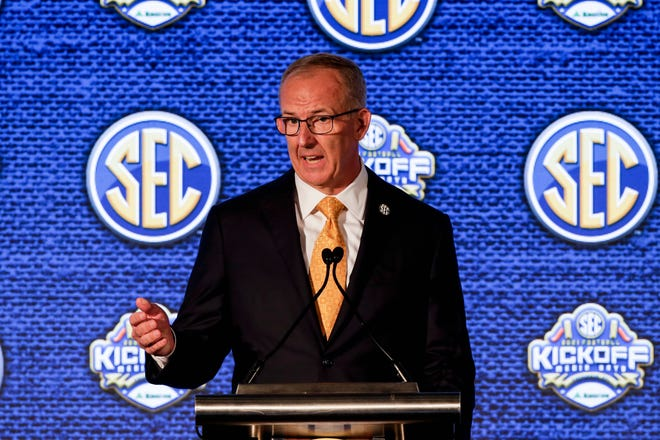 SEC Commissioner Greg Sankey speaks to reporters during the NCAA college football Southeastern Conference Media Days.