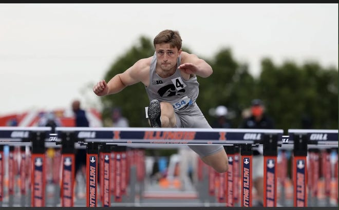 Will Daniels competing in the high hurdles