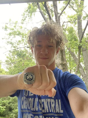 Indiana University wrestler Derek Gilcher displays the ring he got as a freshman when his Detroit high school won the state wrestling championship. It was recovered after all four of his high school championship rings were stolen.