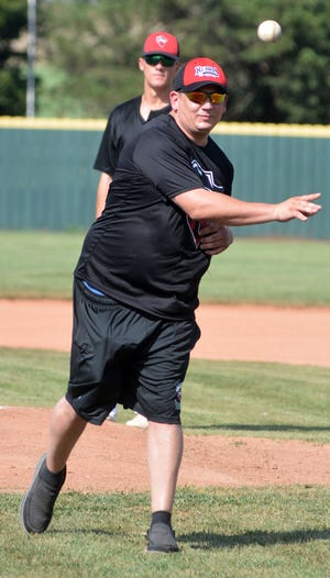 Sgt. John Abel, U.S. Army, throws out the first pitch Saturday before the Newton Rebels-Hutchinson Monarchs game on Military Appreciation Day at Klein-Scott Field. Sgt. Abel served in the Army from 2001 to 2014. He was assigned to the Fort Riley Quick Reaction Force in May 2002. The unit was deployed to Iraq. He also served in Afghanistan. His awards include the Purple Heart, three Silver Stars, a Bronze Star with Valor, a Bronze Star with Oak Leaf, a Meritorious Service Medal, six Army Accomodation medals — one with Valor and seven Army Acheivement medals.