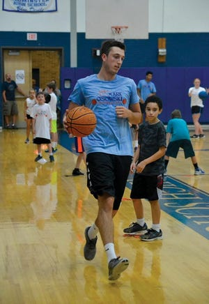 Instructors and students participate in the final day of the 2016 Mark Osowski Basketball Clinic at Leominster High School.