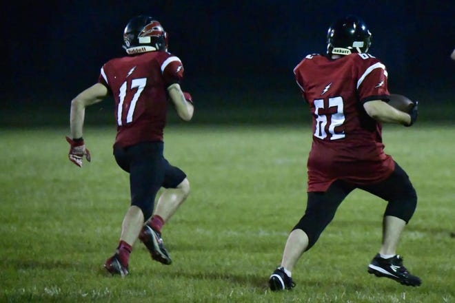 Jesse Gerweck (right) runs for an 82-yard touchdown as Jon Carrabino (17) leads the blocking Saturday. The longest run in team history capped a 48-8 victory over the Lansing Crusaders.