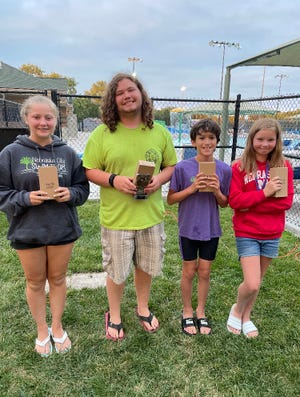 The 110 percent award, chosen by the Nebraska City swim team coaches, goes to swimmers who work hard, don't miss practice and, do more than what the coaches expect of them. From left are  Madisen Tietz (11 & over), Kiernan Hall (11 & over), Jordan Pfeiffer (10 & under) and Lilly Schnitzer (10 & under).