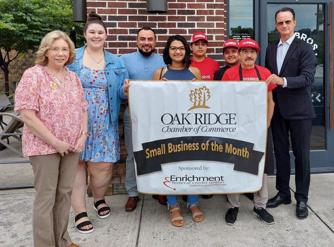 Alfredo Geurrero and his wife Alejandra Santamaria, center and their Dos Bros Fresh Mexican Grill team gather for the Small Business of the Month presentation with Chamber ambassadors Cynthia Jeffers, of Herron-Connell Insurance Agency, from left, and Whitley Myers from ORUD Natural Gas, who nominated Dos Bros. Craig Peters, far right, is president of Enrichment Federal Credit Union, the sponsor.