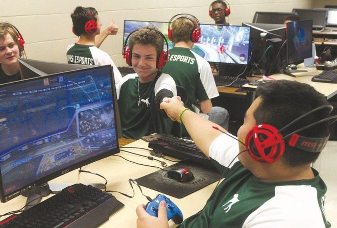 Jordan Deuley gives a fist bump to Van Buren Esports teammate Joseph Calderon during a Rocket League match. STEM, media, and eSports are among the many activities offered at several schools in the River Valley this fall.