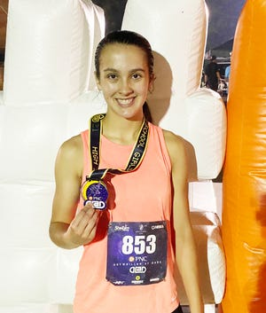 Jaden Lucas of Pontiac competed at the Detweiller at Dark cross country meet over the weekend. Lucas finished 22nd out of 380 competitors in the high school girls' division.