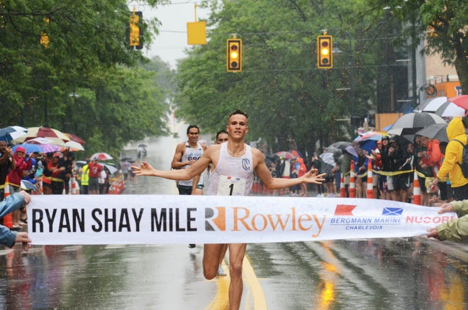 Casey Comber crosses the finish line in the men's race of the Ryan Shay Mile in Charlevoix first Saturday, followed by Jack Anstey and Elias Graca.
