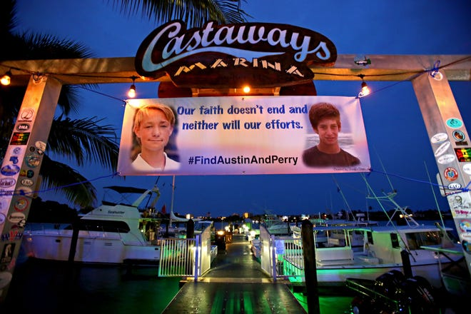 A banner hangs at the Castaways Marina with pictures of Austin Stephanos and Perry Cohen. After 8 days of searching the ocean, the U.S. Coast Guard ended their search for the boys. Friends and relatives attended a fundraiser at the Square Grouper on July 31, 2015 in Jupiter.
