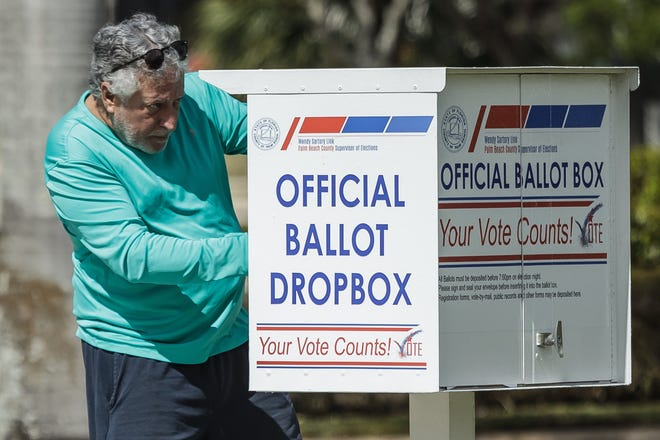 A man drops off a ballot at the official ballot dropbox located at the Palm Beach County Supervisor of Elections office in unincorporated Palm Beach County on Tuesday, March 9, 2021.