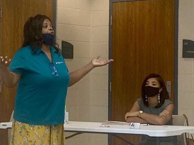 Sonja Smith of the Louisiana Housing Corporation explains the steps for residents to become first-time homeowners. Also shown is Keller Williams realtor Kay Snowten of Smart Choice Home Warranty.