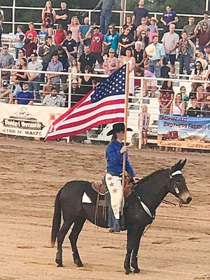 Ruby Howell (Pratt County 4-Her) and her mule Molly have spent the summer training with a central Kansas drill team and performed last weekend at the Pretty Prairie Rodeo with great success.