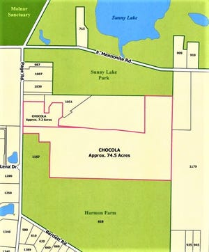 This map shows the location of 83.3 acres the city is buying on Page Road. Two parcels are outlined in red, and the third parcel is the small rectangle just below the three privately-owned properties near the Page-East Mennonite intersection and to the left of another privately-owned parcel. Sunny Lake Park is at top and the former Harmon farms are at bottom north of Bartlett Road.