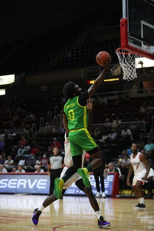 Dwayne Benjamin goes in for a layup during Sunday's victory.